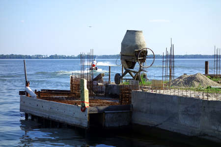 Construction of a lake pier under construction