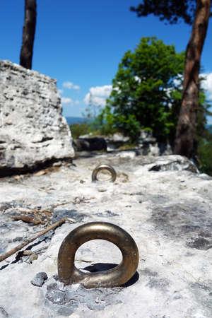 Climbing anchor on a travertine rock