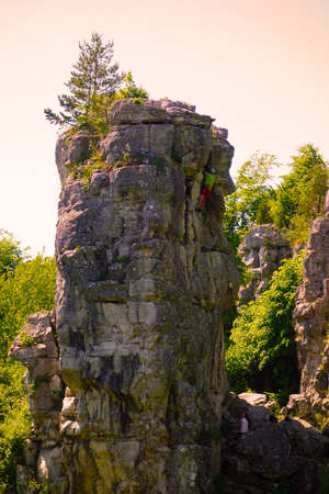 Travertine rock with climber in Dreveník Slovakia, the area is also called as heaven