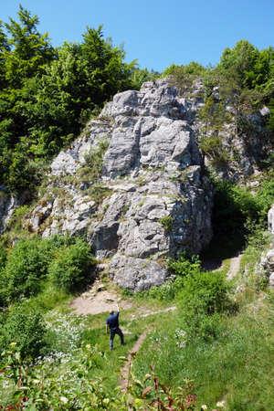 The photographer photographs a travertine rock in the Dreveník area of Slovakia