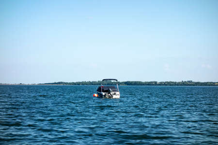 Motor boat moored on the lake in a recreation center