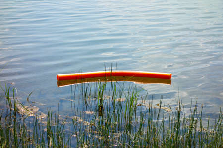 Rescue swimming pontoon in the lake by the shore