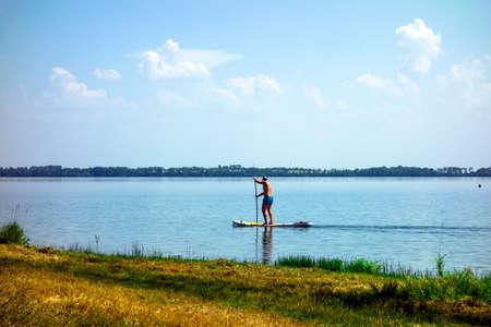 Summer sports activity on a paddleboard 免版税图像
