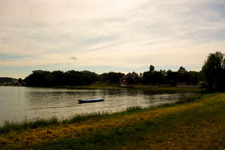 View of the beautiful grassy beach by the large recreational lake Zemplínska Šírava in the summer season