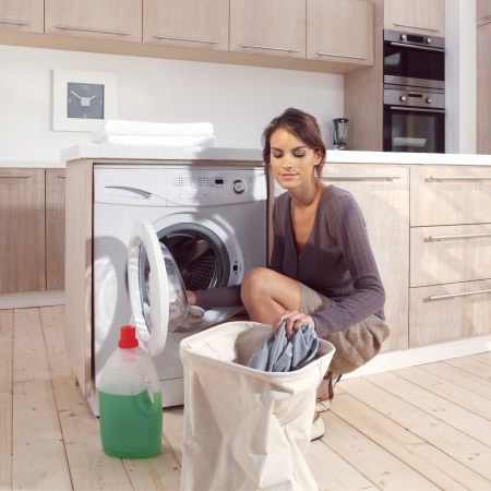 thinking machines: pretty smiling girl in the laundry room