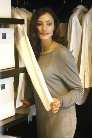 Portrait of a mature woman selecting clothes near wardrobe photo