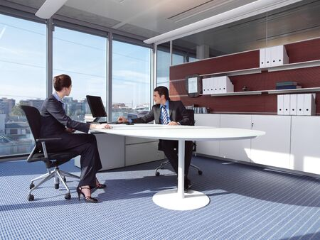 Business couple working at office photo