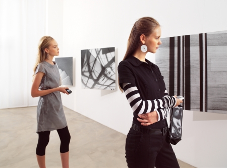 exposition: women with mobile phones at an exhibition  Stock Photo