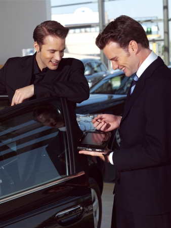young business men working out side of office in car photo