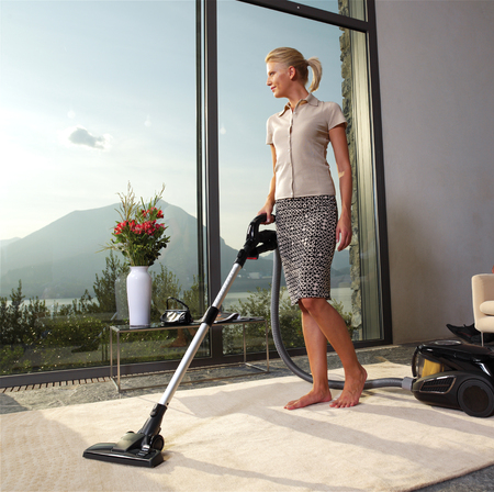 Housework, vacuum cleaner, young couple, home, kitchen. Housework  photo