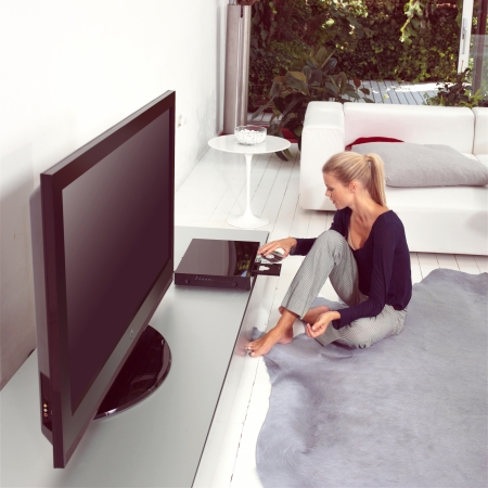 woman using dvd player in living room photo