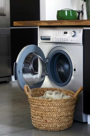 basket: Interior of luxury laundry room with washing mashine Stock Photo