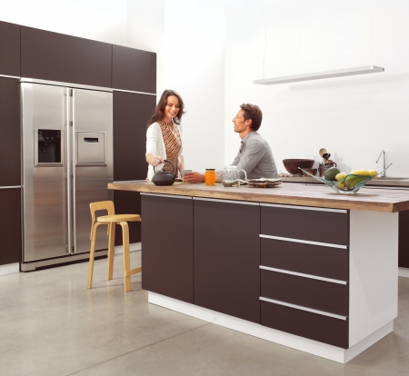 stainless steel range: couple in the modern kitchen interior design photo