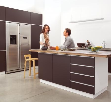 cabinets: couple in the modern kitchen interior design photo
