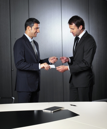 bandy: Businessmen changing business cards Stock Photo