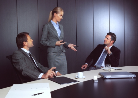 Modern business people working at seminar