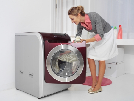 young woman doing laundry photo