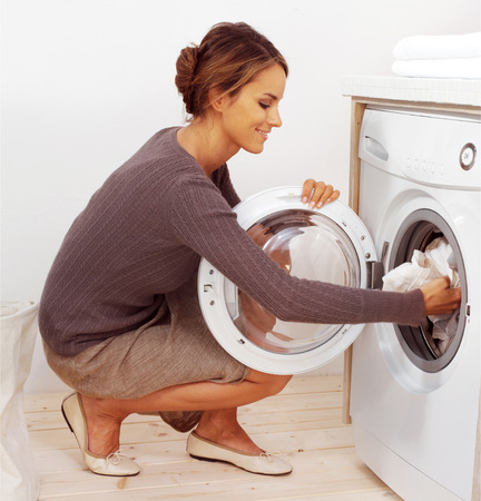bright housekeeping: Housework, young woman doing laundry
