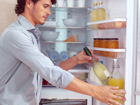 icebox: Man near Refrigerator Stock Photo