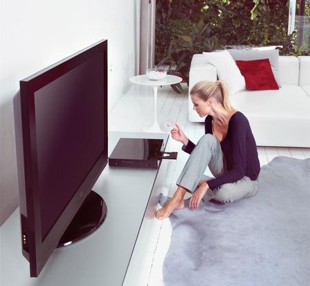 Woman in living room watching home cinema