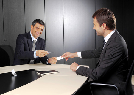 Business meeting at office lobby, people changing business cards