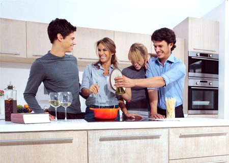 Attractive young people in the kitchen