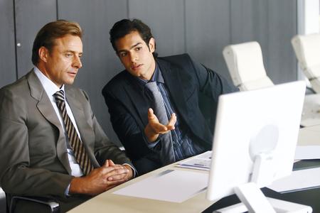 Portrait of a group of business men working together at a meeting Reklamní fotografie