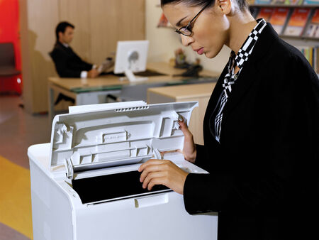copy machine: Portrait of young business woman using the photo copy machine  Stock Photo
