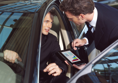 businesmen working inside a car Reklamní fotografie