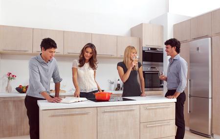 Group Of Young Friends Preparing Breakfast In Modern Kitchen Reklamní fotografie