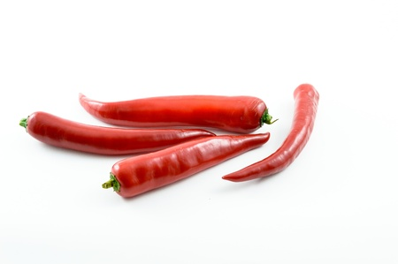 red chili peppers isolated on a white background Stock Photo - 15674821