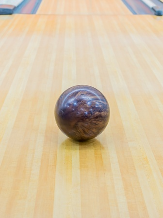Brown bowling ball with Bowling alley. photo