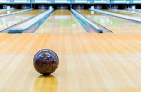 Brown bowling ball with Bowling alley.