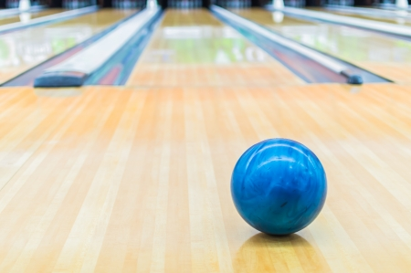Blue bowling ball with Bowling alley. photo