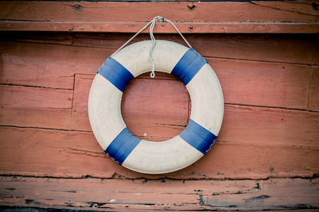 lifebuoy blue stripes. attached to side of the ship. readily available. Stock Photo