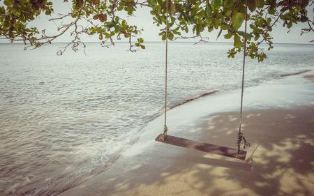 Swing on a tropical beach at Koh Chang island.Thailand photo