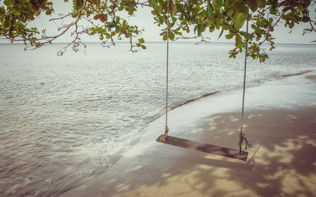 Swing on a tropical beach at Koh Chang island.Thailand photo