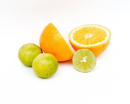 fruity: Slice of fresh orange and Slice of fresh lime on white background.Healthy citrus fruity food. Stock Photo