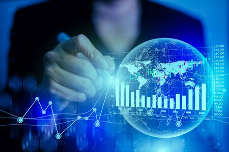 Business Financial Trading Investment concept. Businesswomen use a pen to write information with stock market graph data. Hand drawing increasing graph on signal network coverage around the world.