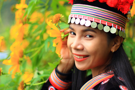 tradition: woman portrait wear hill tribe costume with yellow flower