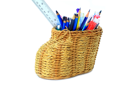 isolated,basketry pencil holder with many pencil,pen,ruler colorful on white background