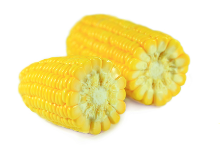 close up yellow fresh half corn raw delicious isolated on white background
