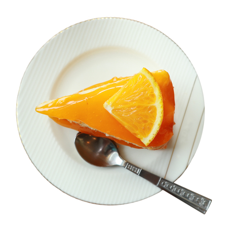 clipping path,orange cake on the saucer isolated on white background,tasty sweet dessert on white plate,homemade piece tasty fruit cake for celebration in family