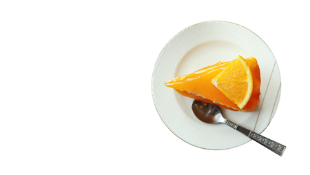 clipping path and copy space,orange cake on the saucer isolated on white background,tasty sweet dessert on white plate,homemade piece tasty fruit cake for celebration in family Standard-Bild