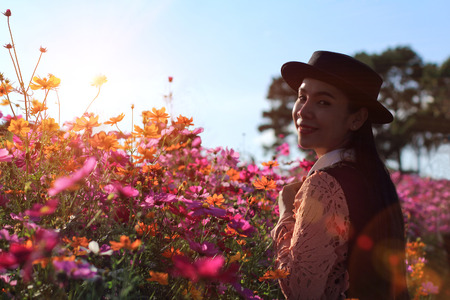 Silhouette portrait lady in flower field at sunrise Imagens