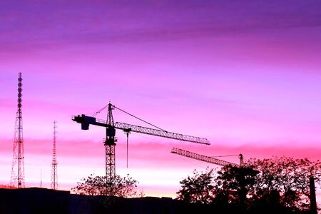 silhouette of construction site at sunset in evening time Banque d'images - 133677363