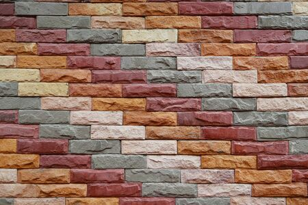 colorful of pattern wall,close up old red brown white brick wall and rough texture background,vintage surface design for decorative interior,concrete with construction and architecture