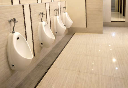 toilet men with row orderly urine bowls and luxury modern style, Interior and design resting room for men Stockfoto