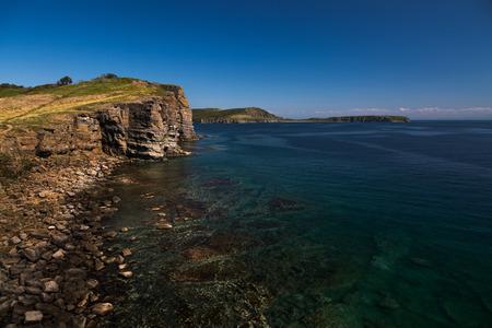 rocky coastline: rocky coastline of the island near Vladivostok in early autumn
