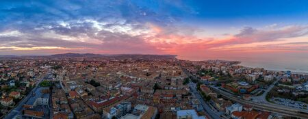 Aerial panorama of popular travel destination beach town Fano in Italy with sunset blue, red, purple sky near Rimini in the Marche region.